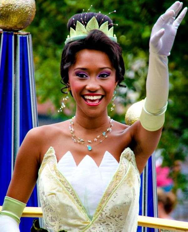 Princess Tiana posing for a photo at one of the Disney parks.