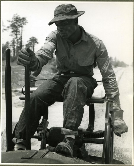 Controlling a road surfacing roller, Beltsville, Md., May 1940