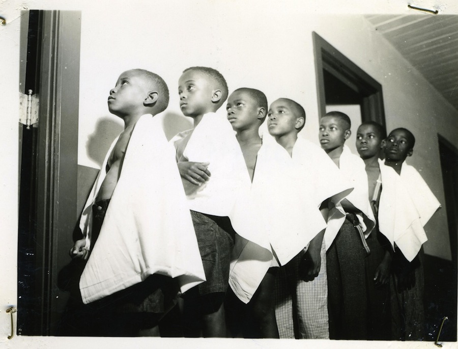 Birmingham, Ala., June 1938, boys wait their turn in line for examination at the Slossfield Health Center, constructed by the Works Progress Administration