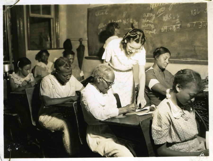 A WPA literacy teacher instructs 87-year-old Julia Wilson, Birmingham, Ala., June 1938