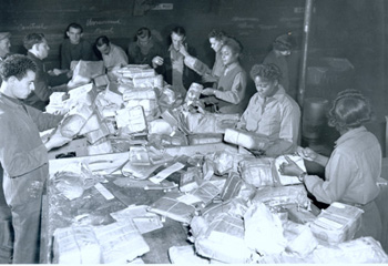 "WACs of the 6888th Central Postal Directory Battalion (CPDB) ""WomenÕs Army Corps members sort packages taken from the mail sacks by French civilian employees at the 17th Base Post office in France.  Black women could serve overseas when requested by the theater commander and did serve in the European and Pacific Theaters of Operations."" National Archives"
