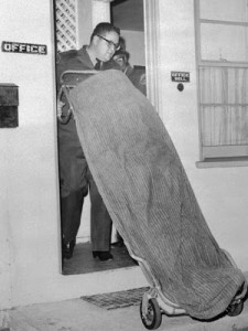11 Dec 1964, Los Angeles, California, USA --- The body of Sam Cooke, 29-year-old Negro recording star, is removed from the office of a motel here 12/11. According to police, Cooke was shot and killed by the manager of the motel when he kicked in the door of her apartment. Officers said they learned later that Cooke was searching for a female companion who was located later. --- Image by © Bettmann/CORBIS