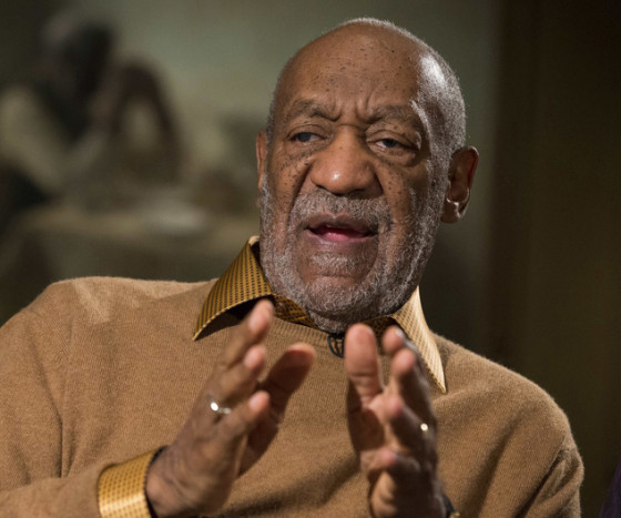 FILE - In this Nov. 6, 2014 file photo, entertainer Bill Cosby gestures during an interview at the Smithsonian's National Museum of African Art, in Washington. The Smithsonian now plans to acknowledge the sexual-assault allegations against Cosby at its new African-American history museum on the National Mall, which will include two items related to Cosby's career in television and standup comedy. (AP Photo/Evan Vucci, File)