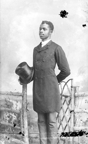 African American man holding a top hat