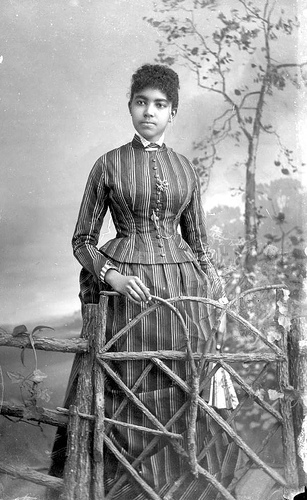 African American woman in striped dress
