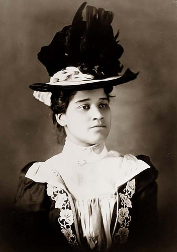Black African American wearing a fancy bonnet