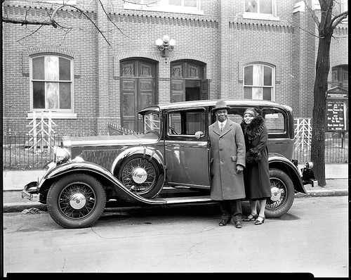 Dr. and Mrs. E.C. Smith w car