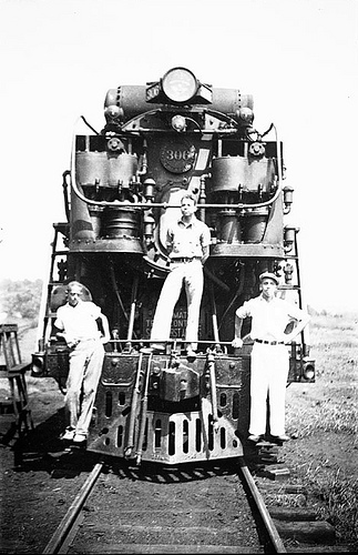 Three African American men on a locomotive
